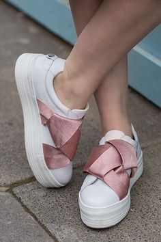 Have a bit of fun with your casuals with Kurt Geiger London's new Laurel slip-on. Set on a season-ready flatform sole, this white sneaker is finished with a pretty-in-pink oversized bow feature to the upper.
