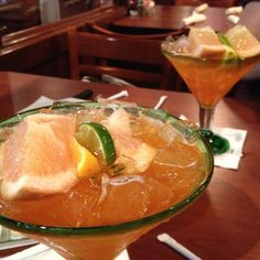 Tangerine Grapefruit Margarita.  4 oz tangerine juice, 4 oz grapefruit juice, 6 oz of your favorite tequila, and 2 oz Triple Sec. Squeeze of lime and top off with fruit.  Really yummy frozen.