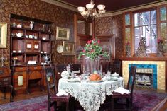 Dining Room:Astonishing Victorian Style Dining Room With Round Dining Table Plus White Table Cloth Also Maroon Red Floral Wallpaper Using Tall Glass Flower Vase Centerpieces Feat Under Mount Wall Shelves Luxurious Classic Victorian Dining Room Decor Ideas