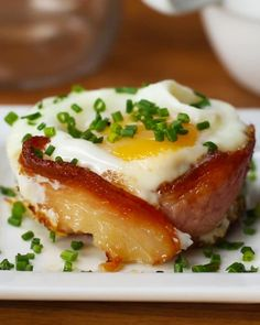 Servings: 4-6INGREDIENTS6 slices bacon6 eggs Salt, to tastePepper, to taste¼ cup cheddar cheese, shredded Chives Special Equipment:Muffin tinPREPARATIONPreheat the oven to 400°F/200°C.Place the slices of bacon in the muffin tin wrapping in a circle. Bake the bacon for 10 minutes. Crack one egg into each of the cups and sprinkle with salt, pepper, and cheddar cheese. Bake again for another 10 minutes or until egg yolk is at desired consistency. Run a knife around the edge of each cup to…