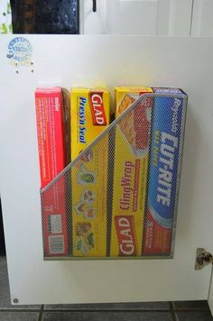 Attach a metal magazine holder to the inside of your kitchen cabinet for storing. Brilliant!!