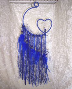 This lush, intensely blue dreamcatcher embodies the medicine of Owl: clairvoyance, astral projection, and magic.    FeatheredDreams has created