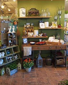 Botanica Gift Shop and Greenhouse early fall merchandise includes glass pumpkins, decorative candle holders, vases and serving accessories