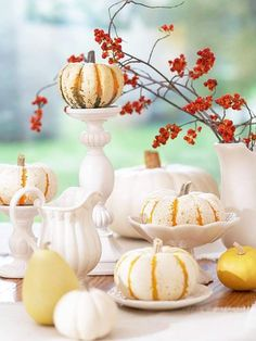 Centerpiece with White Dishes and Pumpkins - for the love of white! This is fab! http://www.bhg.com/thanksgiving/indoor-decorating/easy-centerpieces-for-thanksgiving/#