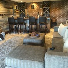 Rustic Basement | ProSource Wholesale The transformation turned into a rustic man cave where the family now spends the most time! A custom built in bar, exposed brick and barn wood wall and oxidized copper ceiling are just some of the features added to this space.