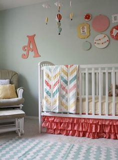 Love the color scheme - but baby girl's room is board and batton on the bottom and a little more light blue-ish green than gray on top.  Would love to use these colors to make it more beachy rather than hot air balloon - Colorful Hot Air Balloon Themed Baby Girl Nursery Room Reveal | Baby Lifestyles