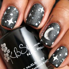 """Continuing with my night time theme, I decided to try a crescent moon and stars :) I used @kbshimmer's """"Eclipse"""" as my base; I'm pretty sure it's the epitome of perfection in black polish.  I also used @mentalitynailpolish's Matte Top Coat.  Details on how I created the moon is on #leblog (link in bio)..."""