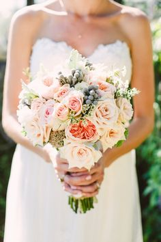 "From the bride...""My bouquet was mostly soft pinks – Juliet Garden roses, blush sahara roses, brunia berries, and sedum edged in dusty miller leaves and wrapped in burlap and lace. "" / Brett and Jessica Photography"