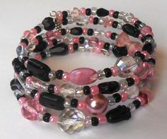 New jewelry - unique, handmade bead memory wire bracelet! Pink and Black Memory Wire Bracelet by VineDesignBeads on Etsy, $16.00