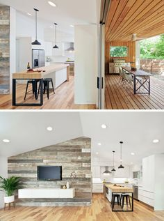 In this modern kitchen, white cabinets are paired with a large island that features a wood counter. Beside the kitchen is a wood accent wall that's home to the television and floating cabinet. #ModernKitchen #KitchenIsland #WoodAccentWall