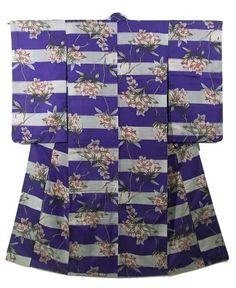 This is an elegant Meisen Kimono with a rhododendron in tiers pattern, which is woven