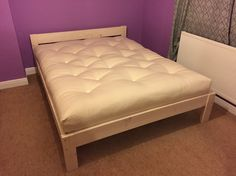 Kingsize cottage bed in white stain with a cotton futon mattress