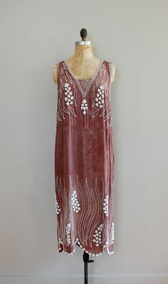 1920s hand-dyed crepe dress with thick white beading throughout. very open at the sides with dropped waist and scalloped beaded hem
