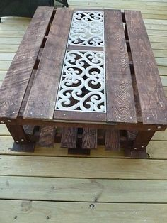 Our Pinteresting Family: Pallet Coffee Table with iron center.
