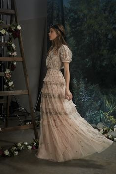 The ultimate event gown for the new season. The Victorian-inspired Jet Frill Gown in pink is crafted in frothy tulle and finished with delicate beading. Glassy buttons adorn the textured bodice of this embellished maxi dress, and the tiered tulle skirt catches the light as you move.