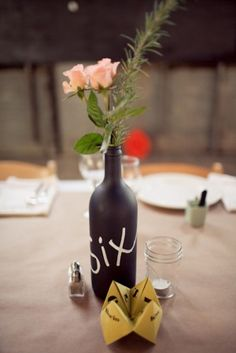 Bottles double as table numbers. New York Wedding by Isabelle Selby