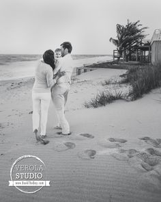 Love the black and white and the footprints. #family #photography #beach #blackandwhite #verolastudio
