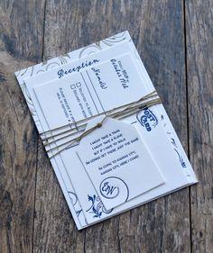 Navy blue and gold letterpress wedding invitation.