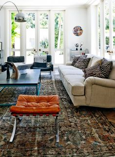 Living room with textured and animal print accents.