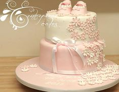 baby shoes christening cake by Centrepiece Cakes