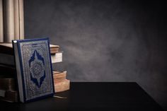 Koran - holy book of Muslims ( public item of all muslims ) on the table Premium Photo Black Background Wallpaper, Framed Wallpaper, Cute Wallpaper Backgrounds, Galaxy Wallpaper, Muslim Images, Islamic Images, Islamic Pictures, Islamic Art, Quran Wallpaper