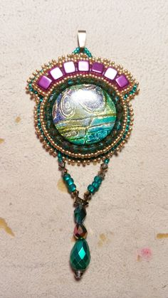 Beaded pendant with a wonderful polymerclay cabochon made by the talented Tina Holden (Beadcomber Supplies), seedbeads, firepolished- and tila-beads. Made by Alexandra Reiner Etsy shop Chest of Beads. Turquoise Necklace, Polymer Clay, Pendants, Necklaces, Etsy Shop, Pendant Necklace, Beads, Purple, Sweet
