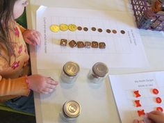 Kids choose a jar of tokens and graph them on graph paper.