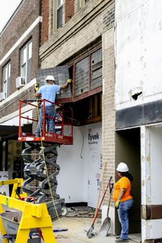 A worker removes a pane from the Sheldon-Munn building on Wednesday morning. The panes are believed to be designed by Frank Lloyd Wright and are made by Luxfer Prism Company near the turn of the 20th century. Photo by Megan Wolff/Ames Tribune http://www.amestrib.com/news/20160928/renovation-of-sheldon-munn-uncovers-exciting-find