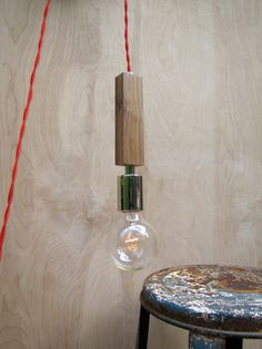 Modern Trouble Light in Walnut / Hanging Wooden Bare Bulb Pendant  / Handmade Wood Lamp. $120.00, via Etsy.
