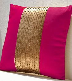 Sequin pillows in hot pink silk and gold color block on art silk with sequin bead detail. This elegant decorative pillow is intricately beaded in gold squares and beads to form a solid gold pattern th