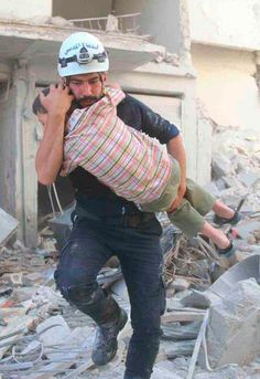 """White Helmets - a volunteer group in Syria who runs to bomb sites to save as many people as they can-no matter enemy or friend, young or old. They have volunteered and left their jobs in order to save humans. These are the stories that need to be told. As Mr. Roger's mom said, """"Look son, find the helpers. In every situation, find the helpers:"""""""