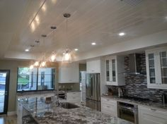 We also raised the ceiling above the kitchen.  A whole-house remodel and addition designed and built by GroningerHomes.com for repeat customers in Maitland, Florida.