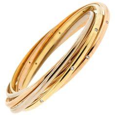 441c9d65cda 1970s Cartier Tri-Color 18 Karat Gold Diamond Rolling Ring Bangle