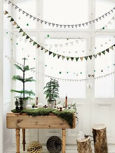 Christmas trees in small versions. I think branches and small trees are super decorative. Go out for a walk and find a broken branch, save it and take it home with you. Buy a small tree you can enjoy indoors for some weeks and then you can plant the tree to grow and live for ever more! – Read more to see all the picks –