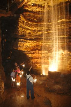Silver Dollar City guests enjoy a guided lantern tour in Marvel #Cave. #branson