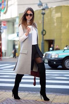 Long vest and long lace boots. Spring outfit