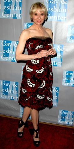 Look of the Day › May 5, 2010 WHAT SHE WORE For an L.A. Gay and Lesbian Center benefit, Zellweger sported a velvet appliqued Carolina Herrera dress and ankle-tie peep-toes