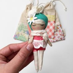 Stunningly original handmade mini mini doll. Mend by Ruby Grace design. Perfect for little hands. High quality materials used. Hand painted face....
