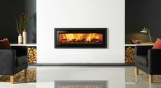 The Stovax Studio Profil inset fire features ultra contemporary styling that fits in perfectly with all modern interiors. The wood burning Studio Profil is Inset Fireplace, Wood Burning Fireplace Inserts, Fireplace Tile Surround, Wood Burning Fires, Modern Fireplace, Fireplace Ideas, Blue Living Room Decor, Living Room With Fireplace, Inset Stoves