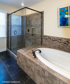 Large soaking tub and a walk-in shower in the #master #bathroom of The Lisenby #1220. http://www.dongardner.com/house-plan/1220/the-lisenby. #DreamHome