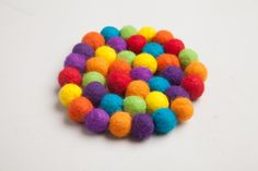 I made this felt ball trivet to brighten up my kitchen for those gloomy afternoons I sit down with a hot bowl of soup. The bright colors of the wool roving really pop in my neutral kitchen. I enjoyed how meditative making the felt balls was, and sewing everything together at the end was a breeze. This project would make a great housewarming present, and I love that I can mix up to colors to customize the gift.