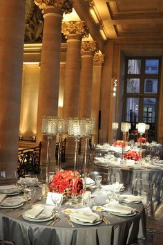 Dinner tables inside the Louvre--stunning but tablescape could be recreated inexpensively with simple candleholder and small floral arrangement!