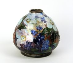 A vase by Camille Faure~Hand applied enamel over a copper body~Depicting a floral scene~Made in France Circa 1930