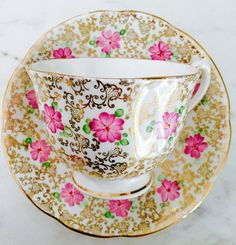 Longton England Pink Floral Golden Chintz 1930's Tea Cup and Saucer by TheBelovedTeacup on Etsy https://www.etsy.com/ca/listing/464899044/longton-england-pink-floral-golden
