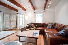 Brown leather couch, beams, lighting