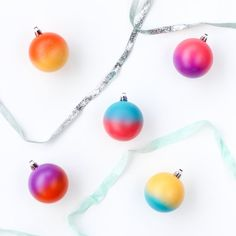 Make your Christmas Tree really pop with these color blocked ornaments! Only takes about 15 minutes and a few cans of spray paint to make.