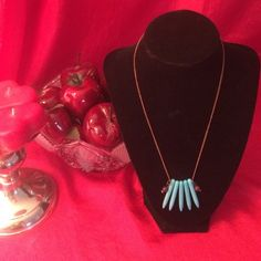 Handmade spiked acrylic turquoise necklace Spiked acrylic turquoise necklace: 18 inch necklace made with five 1.5 inch long acrylic turquoise spikes, brown glass and seed beads on a bronze colored chain with bronze colored accents ✨ price firm ✨ Handmade Jewelry Necklaces