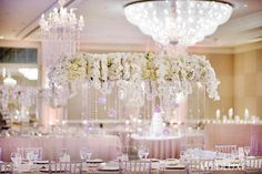 Heavenly doesn't even begin to describe this floating #orchid and crystal #centrepiece! See more from this #Vancouver #wedding on WedLuxe.com, plus get the full story in our new W/S 2017 issue on newsstands NOW! (: @hongphotography, planning and design assistance: @detailsbyhaleh, same-day coordination: @mmeinc, floral: @talaflorist, decor: @uprightdecor, venue: @fairmontwaterfront)
