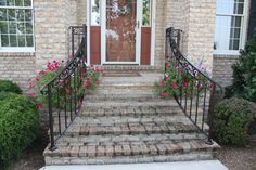 Amazing Wrought Iron Railing For Home Decor Ideas: Exterior Design With Wrought Iron Railing And Brick Steps Also Entry Door With Sidelights And Brick Exterior Siding Plus Handrails For Steps With Flowers And Exterior Handrails Also Windows Patio Steps, Front Porch Steps, Brick Steps, Front Stairs, Outdoor Steps, Stone Steps, Front Porches, Front Entry, Front Doors