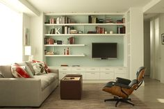off-center tv placement with repeating shelving. Storage below.
